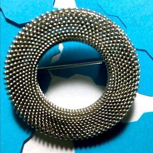 Silver circular brooch